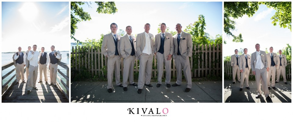groomsmen wearing navy blue ties and tan suits